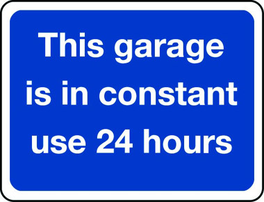 This garage is in constant use 24 hours a day sign
