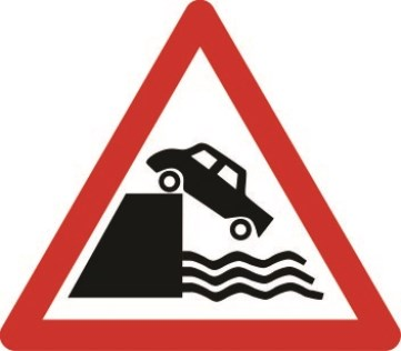 Quayside or river bank ahead triangle