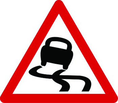 Slippery road ahead traffic sign