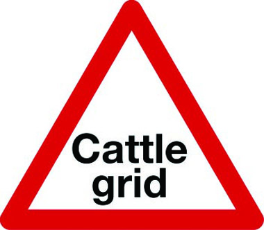 Cattle grid ahead triangle sign