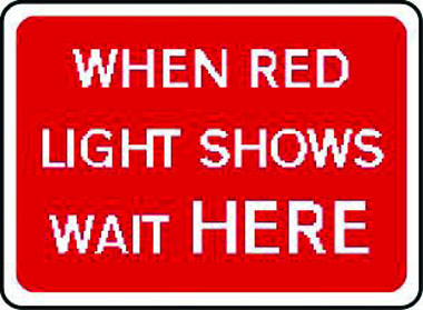 When red light shows wait here traffic sign