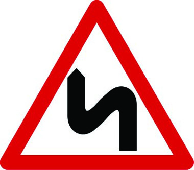 Double bends to the left traffic sign