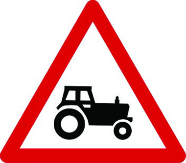 Agricultural vehicles likely ahead traffic sign