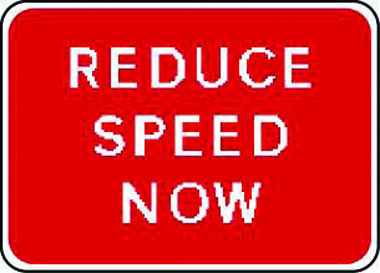 Reduce speed now traffic sign