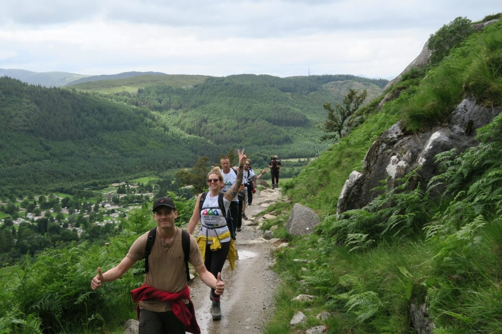 Stocksigns Charity 3 Peaks Challenge Finish Banner River View Walking Group Shot