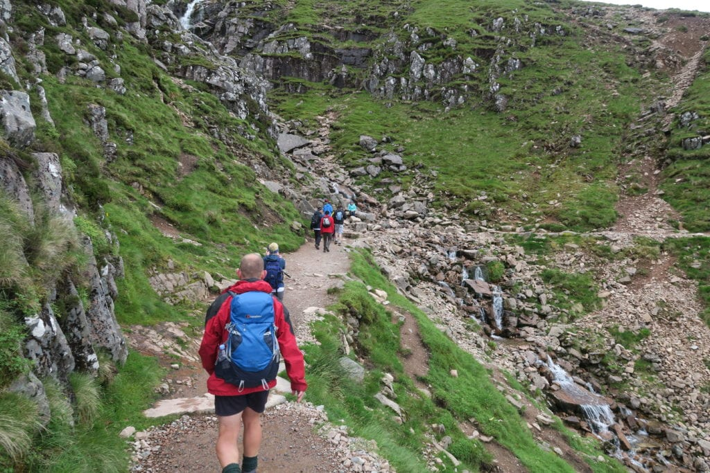 Stocksigns Charity 3 Peaks Challenge Finish Banner River View Walking Mountain Shot