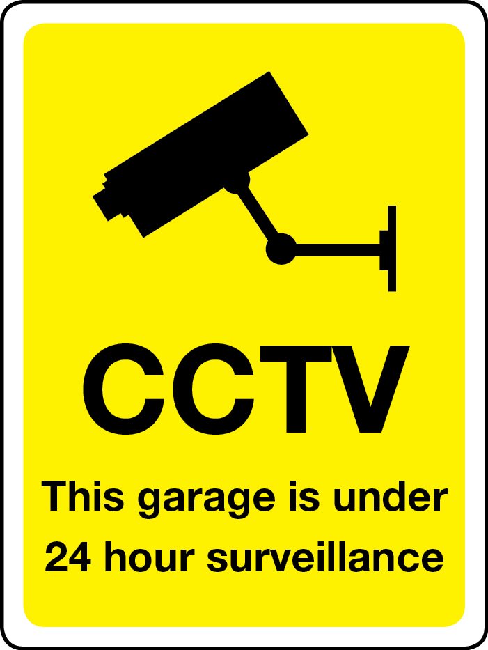 This garage is under 24-hour surveillance sign