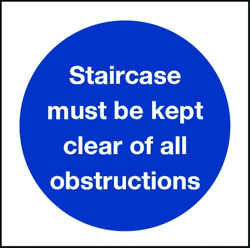 Staircase must be kept clear of obstructions sign