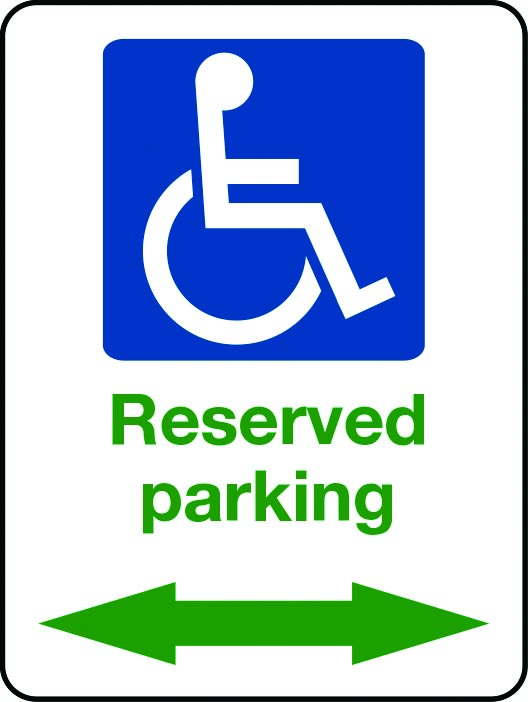 Reserved parking sign with green arrows and wheelchair
