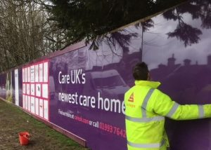 Stocksigns installing Hoarding Panels